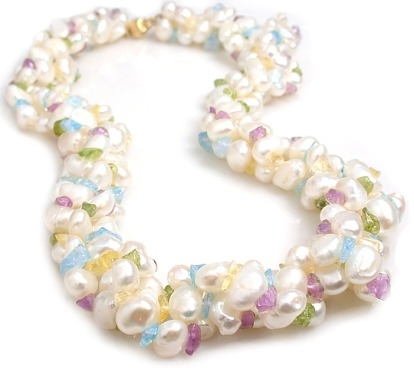 A triple strand of 8-9mm Biwa Pearls gazzed with Peridot, Blue topaz, Amethyst, and Citrine gemstones and a 14kt gold clasp